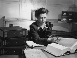 Geologist Diane Loranger at a desk.
