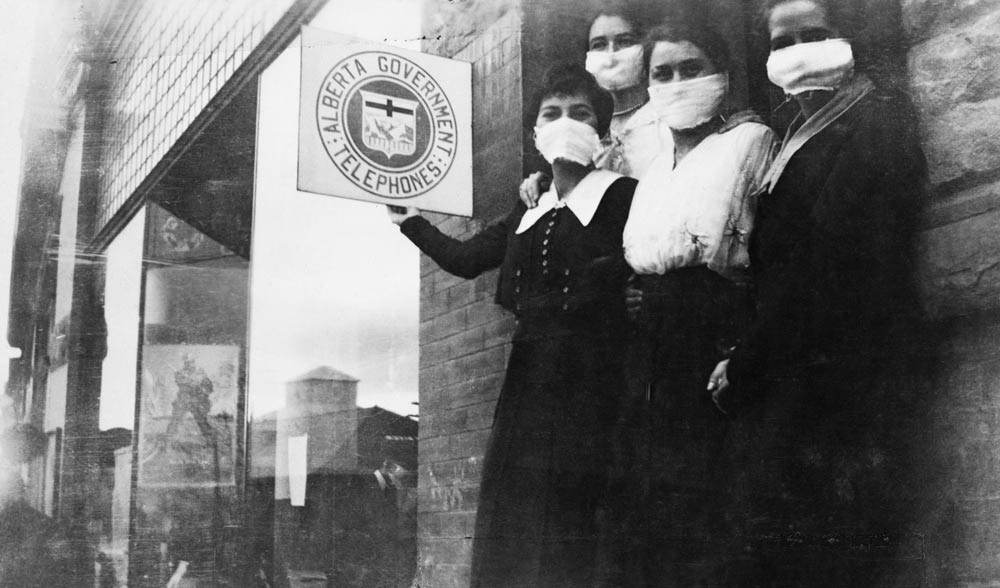 Telephone operators wearing masks to protect themselves from the Spanish flu.