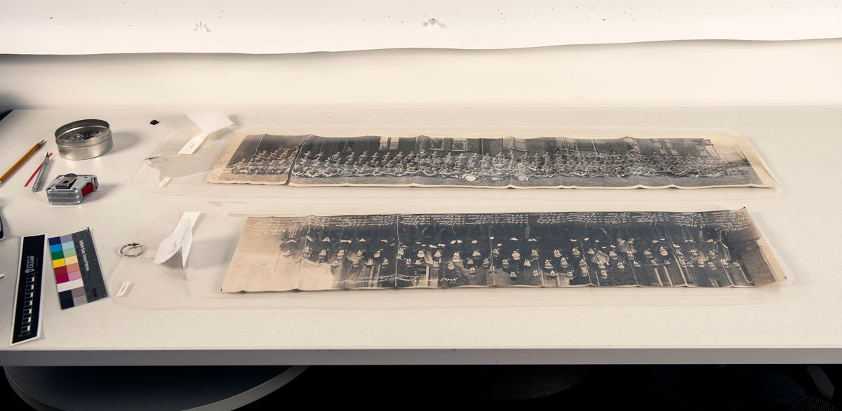 Tears and cracks in two of the panoramic photos of the Glenbow Archives.