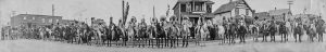 First Nations individuals on horseback as seen in one of the panoramic photos of the Glenbow Archives.