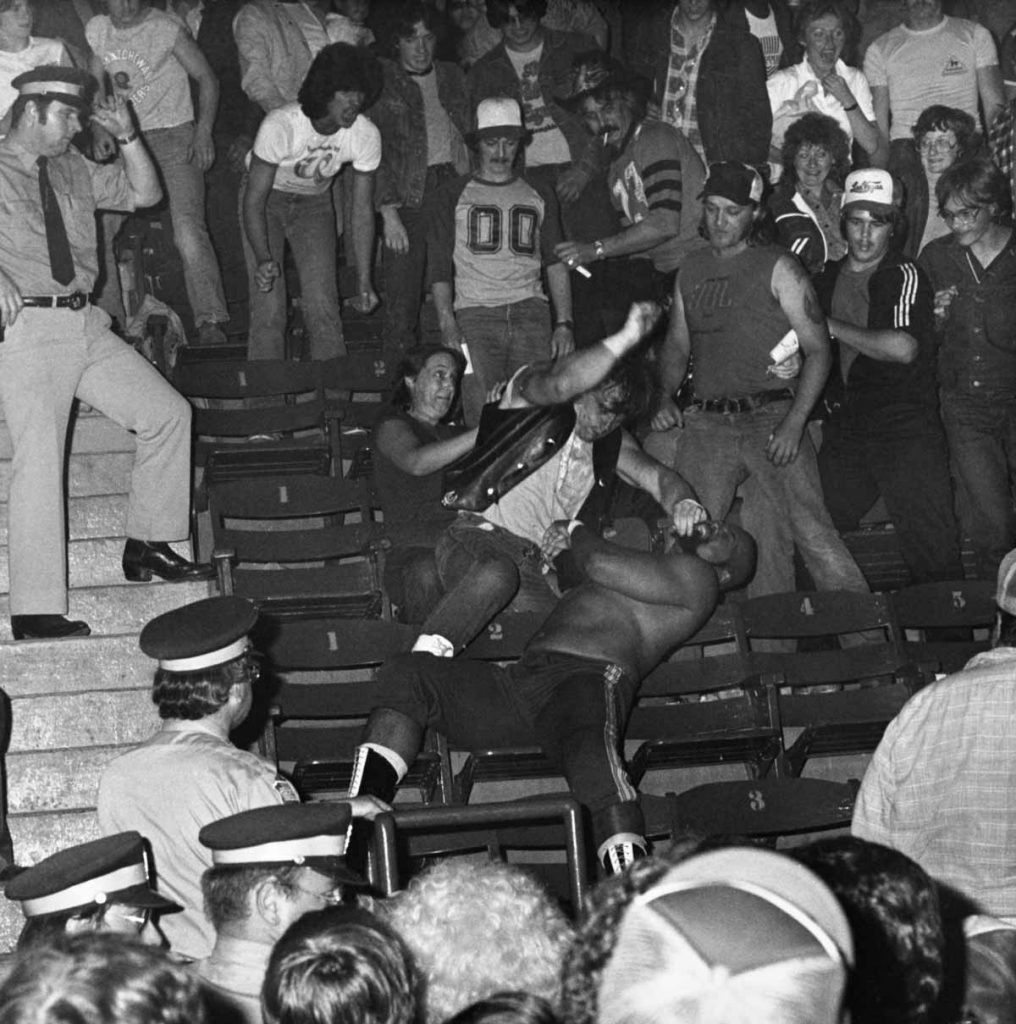 Two wrestlers fight in the stands