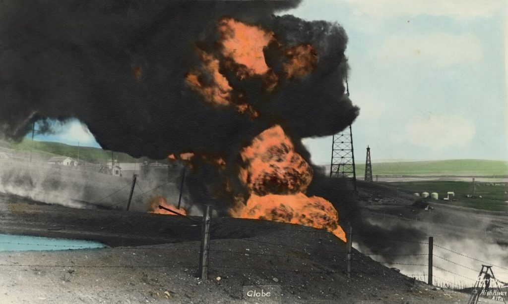 Flames erupt into the sky from an oil well