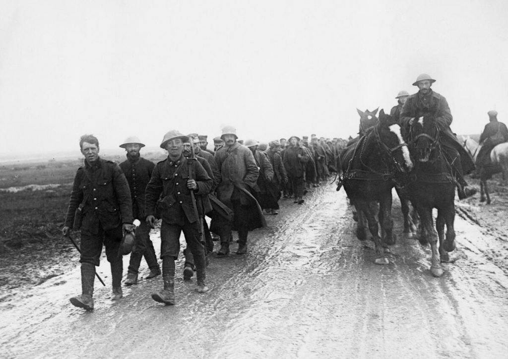 First World War soldiers march along a muddy road in this photograph used to illustrate military history at the Glenbow.
